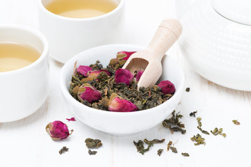 green tea with rosebuds, cups and teapot