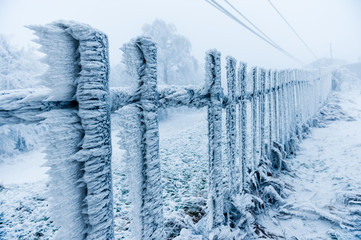 Rime covered fence by the skilift closed due to bad weather