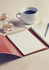 Planning concept,old diary with coffee and pen,vintage filtered