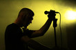 Male singer silhouette on the stage - 77947240