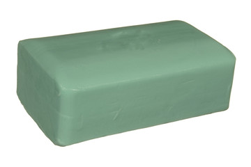 Cake of soap green isolated on white background.