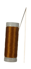 Spool of brown thread and needle isolated on white background.