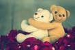vintage lovely hug lovely teddy bears on red rose petals