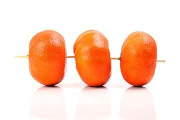 Drei Clementinen am Spieß