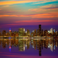 Manhattan New York sunset skyline from East