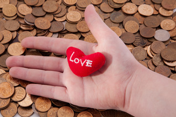 heart on her hand. hand on the money