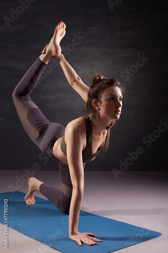 Poster Mature woman practicing yoga on the floor