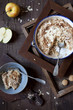 apple crumble with almonds on rustic table with wood frames - 77951613