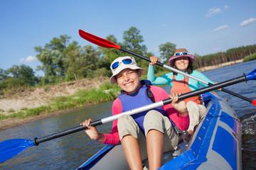 Girl with mother kayaking