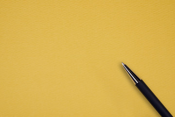 Black ball pen on the yellow papper background