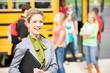 School Bus: Cheerful Teacher By School Bus
