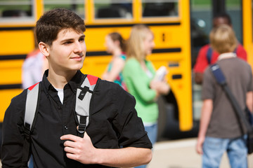 School Bus: Male Student Waiting By Bus