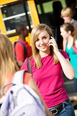 School Bus: Cheerful Girl with Cel Phone