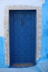 Old Blue Door with Hand Door Knocker