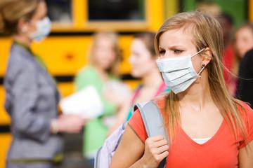 School Bus: Girl Has to Wear Mask to Avoid Disease