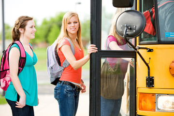School Bus: Girl Looks to Side While Boarding Bus