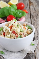 Quinoa salad with vegetables,chickpea and feta.Selective focus.