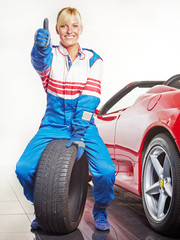 Woman with racing suit in a garage