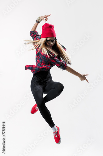 young beautiful dancer jumping on a studio background - 77953646