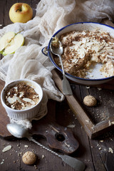 apple crumble with almonds on rustic table