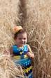 Girl's portrait on a footpath in a wheat field