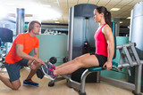 Calf extension woman at gym exercise machine - 77955244