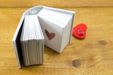 Small open book with a heart shape