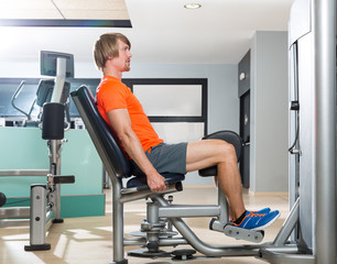 Hip abduction blond man exercise at gym closing