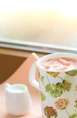 Coffee with milk on the windowsill