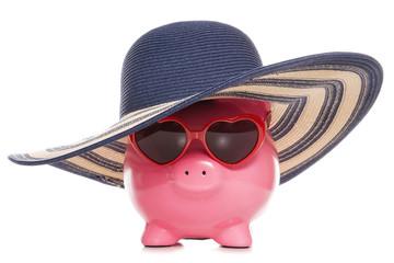 piggy bank wearing a sun hat and sunglasses