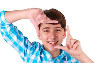 Teenager gesturing finger frame isolated on white