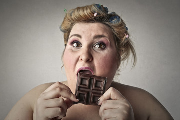 Greedy woman eating chocolate