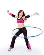 Fitness teacher demonstrating hooping
