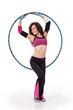 Fitness teacher posing with hula hoop