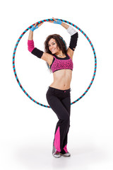 Fitness teacher posing with hula hoop