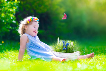 Beautiful little girl playing with a butterfly