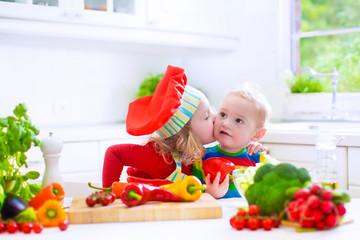 Children preparing healthy vegetable lunch