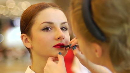 bright red lipstick to perfect young face girl close-up