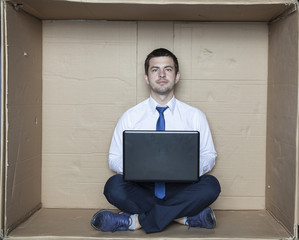 Portrait of a businessman sitting in front of computer