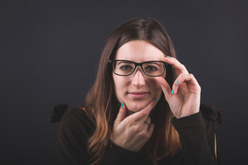 Young Woman with Eyesight Problems on Black Background.