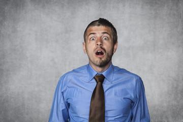 surprised businessman looking in disbelief