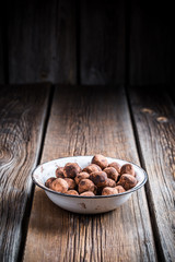 Chocolate balls in a old white bowl