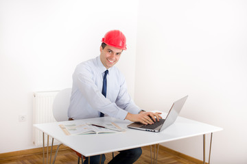Engineer with laptop in the office