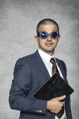 proud businessman with electronic equipment