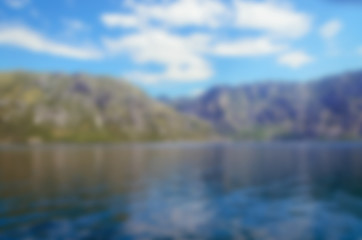 Blurred nature background. Sea and mountains