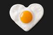 fried egg shaped to heart on teflon pan - 77961622