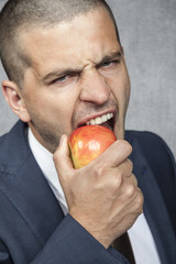 businessman biting the apple