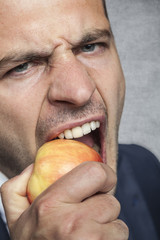 businessman eating an apple