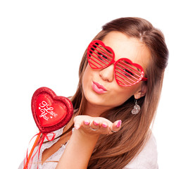 Young woman sending kisses