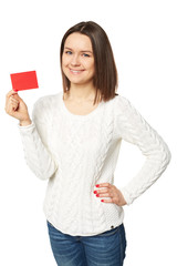 Young woman holding empty credit card, over white background